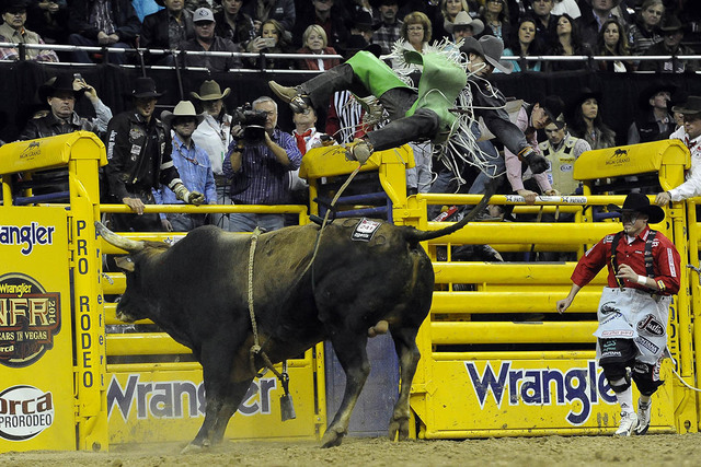 Bull rider Aaron Pass from Dallas, Texas, is bucked off his bull during the tenth go-round of the National Finals Rodeo at the Thomas & Mack Center in Las Vegas, Saturday, Dec. 13, 2014. (Josh ...