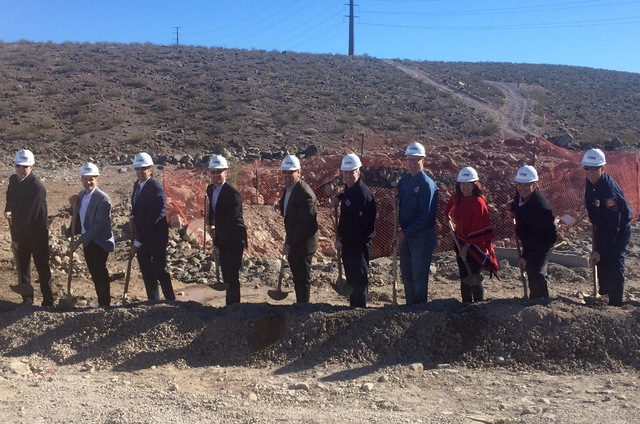 Henderson officials and representatives of Inspirada Builders LLC shovel dirt during the groundbreaking for Fire Station 91, the city's 10th fire station and the first new station to open in 15 ye ...