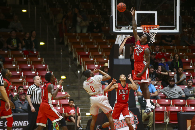 UNLV forward Dwayne Morgan (15) blocks a shot from Southern Utah during a basketball game at the Centrum Arena in Cedar City, Utah on Wednesday, Nov. 30, 2016. Chase Stevens/Las Vegas Review-Journ ...