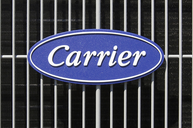 This April 21, 2009, file photo shows the Carrier logo on an air conditioning unit in Omaha, Neb.  (AP Photo/Nati Harnik, File)