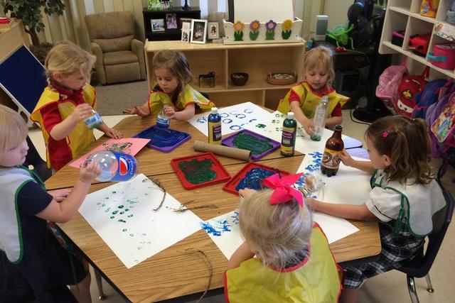 Children work on Earth Day activities during a celebration April 22, 2016, at Merryhill Preschool, 10050 Alta Drive. (Jan Hogan/View)