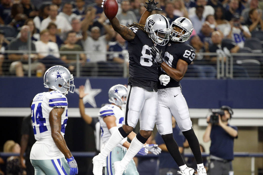 Oakland Raiders wide receiver Amari Cooper (89) and Cordarrelle Patterson, center, celebrate a touchdown catch by Patterson in front of Dallas Cowboys cornerback Nolan Carroll II (24) in the first ...