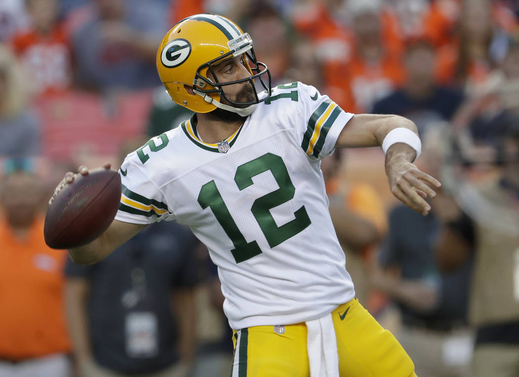 Green Bay Packers quarterback Aaron Rodgers (12) throws against the Denver Broncos during the first half of an NFL preseason football game, Saturday, Aug. 26, 2017, in Denver. AP Photo/Joe Mahoney)