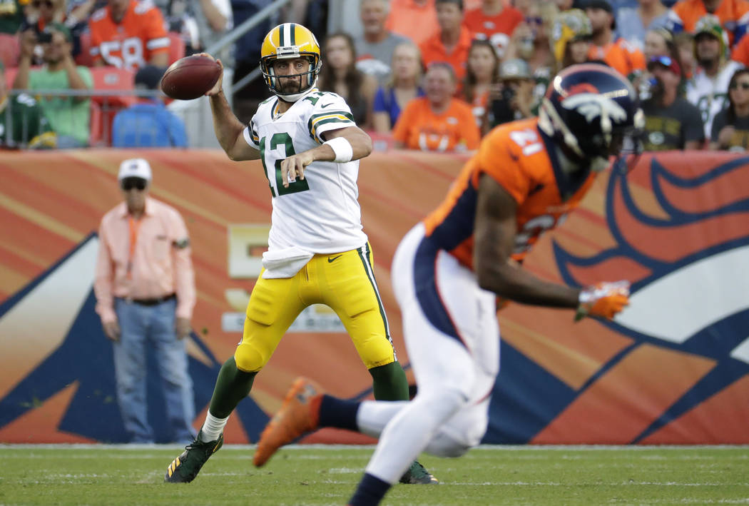 Green Bay Packers quarterback Aaron Rodgers (12) throws against the Denver Broncos during the first half of an NFL preseason football game, Saturday, Aug. 26, 2017, in Denver. AP Photo/Jack Dempsey)