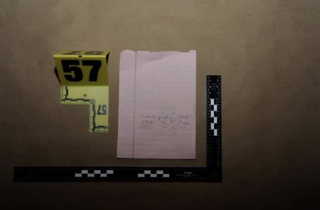 A handwritten note with distance and bullet drop calculations. LVMPD.