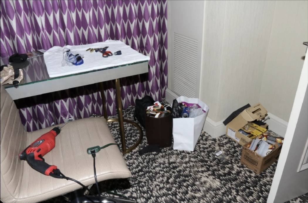 A desk in the master bedroom of 32-135 with a SCUBA mask and a power hand drill. LVMPD.