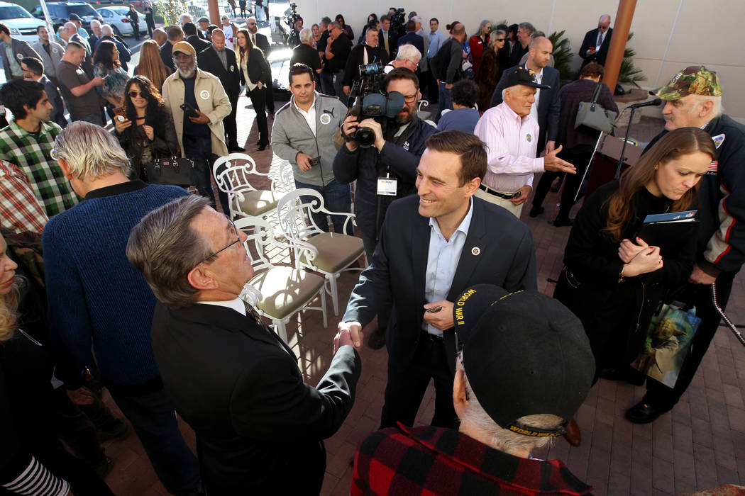 Republican gubernatorial candidate Nevada Attorney General Adam Laxalt, center, greets Bob Reed after speaking at Veterans Village in downtown Las Vegas Wednesday, Jan. 24, 2018. (K.M. Cannon/Las  ...