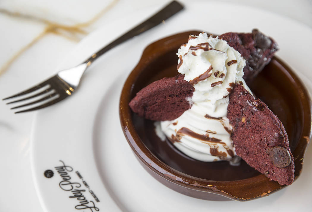 Red velvet lava brownie with red velvet chocolate cookie, double chocolate brownie, molten chocolate ganache, vanilla bean ice cream, chocolate sauce and whipped cream at Lucky Penny on Monday, De ...