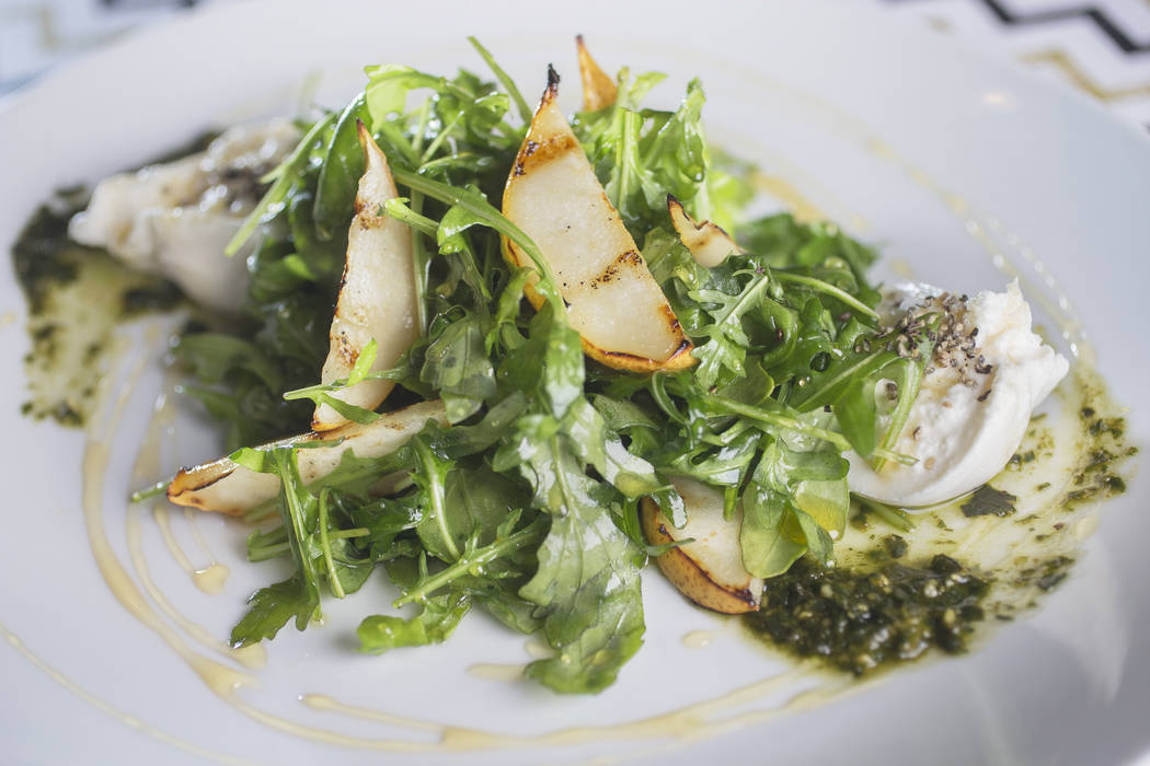 Grilled pear and burrata with arugula, black pepper honey and basil pesto at 7th & Carson on Thursday, December 21, 2017, in Las Vegas. Benjamin Hager Las Vegas Review-Journal @benjaminhphoto