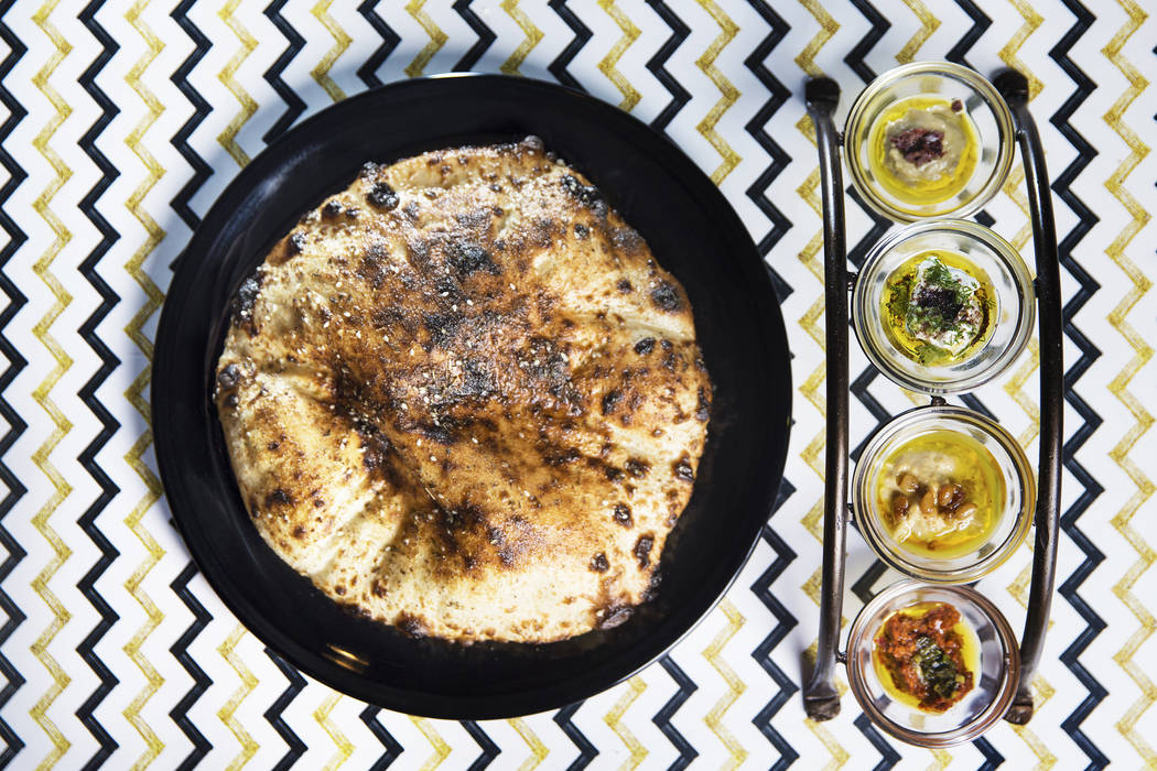 Hearth oven bread and dip with hummus, baba ganoush, red pepper and cucumber yogurt at 7th & Carson on Thursday, December 21, 2017, in Las Vegas. Benjamin Hager Las Vegas Review-Journal @benja ...