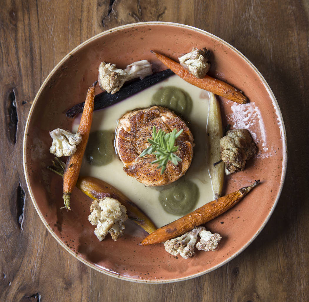 Wild isles salmon mignon with roasted cauliflower, honey & garlic-braised carrots, rosemary cauliflower sauce and caper & raisin emulsion at Hamptons on Thursday, Jan. 25, 2018, in Las Veg ...