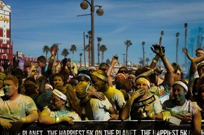 """Participants covered with powder dance after running or walking in the Color Run Las Vegas on Saturday. The annual Color Run, which featured children as well as adults, was called """"a unique exper ..."""