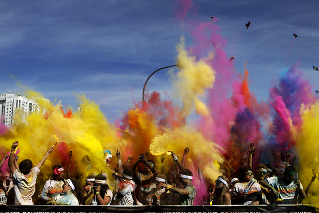 Participants in the Color Run Las Vegas throw up colored powder into the air after participating in the run and walk in downtown Las Vegas Saturday, Feb. 16, 2013. (John Locher/Las Vegas Review-Jo ...