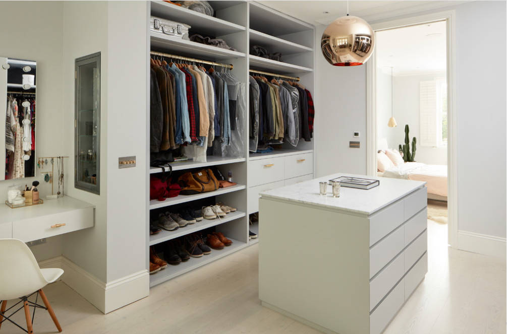 Houzz An all-white space was designed for a homeowner's favorite things.