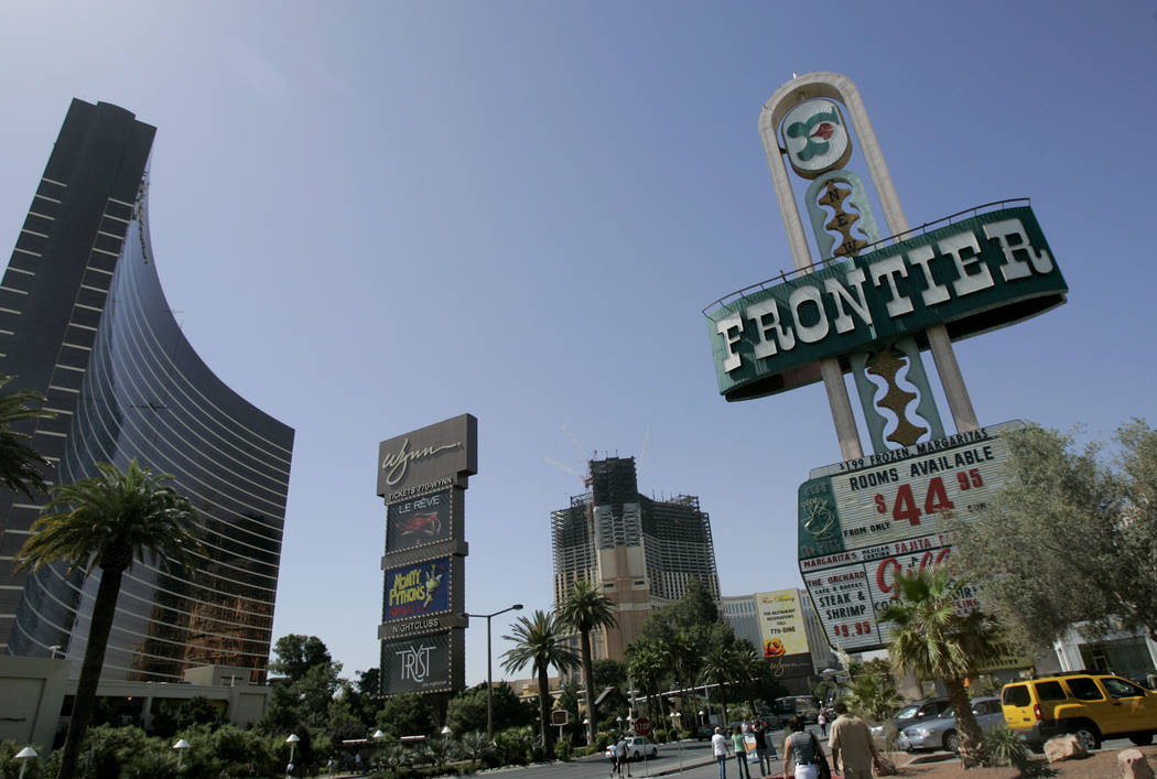 The New Frontier hotel-casino sign, right, is shown on The Strip on Wednesday, May 16, 2007, in Las Vegas.  The owner of The Plaza hotel in New York announced plans Wednesday to buy the property a ...