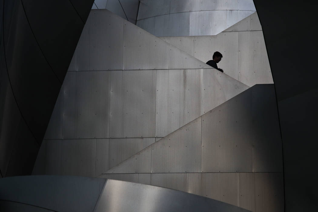 Two visitors walk down the steps of the Walt Disney Concert Hall Friday, Jan. 12, 2018, in Los Angeles. The building was designed by architect Frank Gehry. (AP Photo/Jae C. Hong)