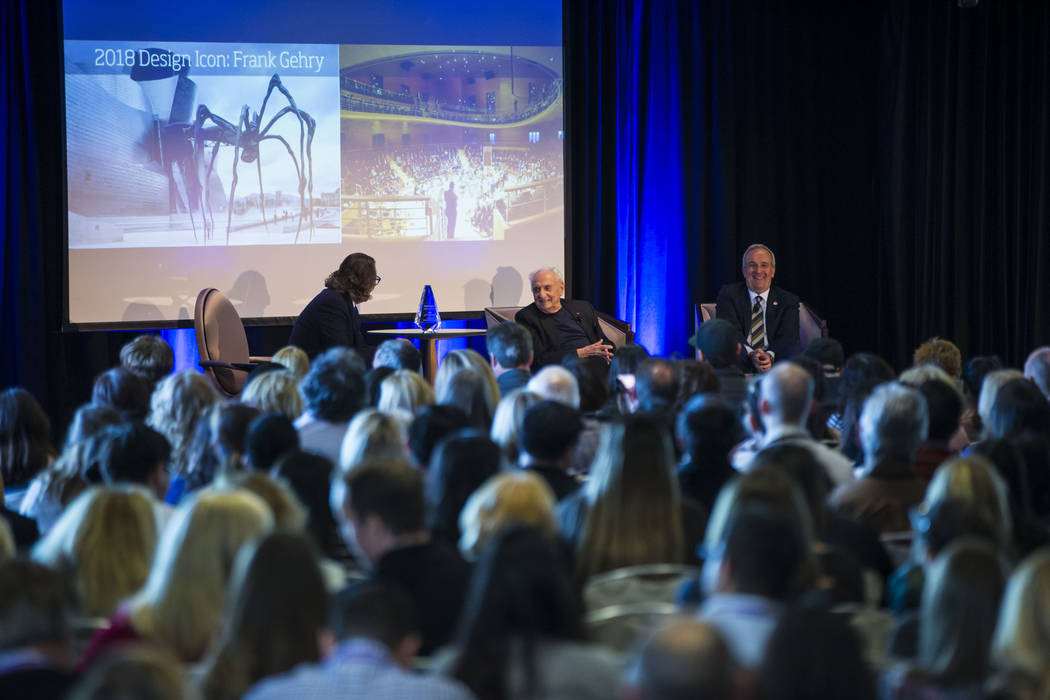 Famed architect Frank Gehry, center, who was named the 2018 Design Icon by Las Vegas Market, speaks during an event honoring him during the Las Vegas Market at the World Market Center in Las Vegas ...