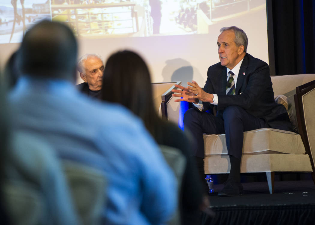 Larry Ruvo, right, who helped start the Cleveland Clinic Lou Ruvo Center for Brain Health, which was designed by Frank Gehry, left, speaks during an event honoring Gehry during the Las Vegas Marke ...