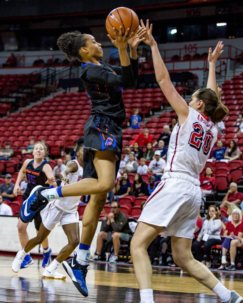 Boise State's A'Shanti Coleman (42) goes up for a shot while UNLV's Alyssa Anderson (20) tries to block her at the Thomas & Mack Center in Las Vegas on Saturday, Feb. 3, 2018. UNLV won 77-54.  ...