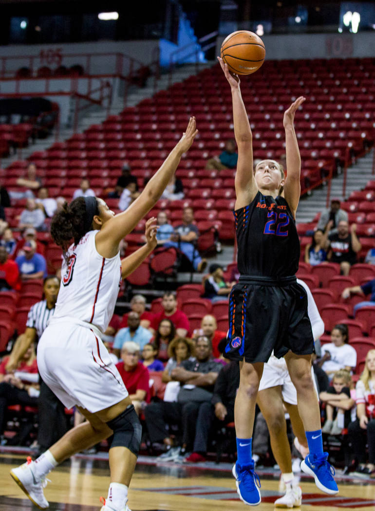 Boise State's Ellie Werner (22) goes up for a shot while UNLV defender Paris Strawther (3) tries to block her at the Thomas & Mack Center in Las Vegas on Saturday, Feb. 3, 2018. UNLV won 77-54 ...