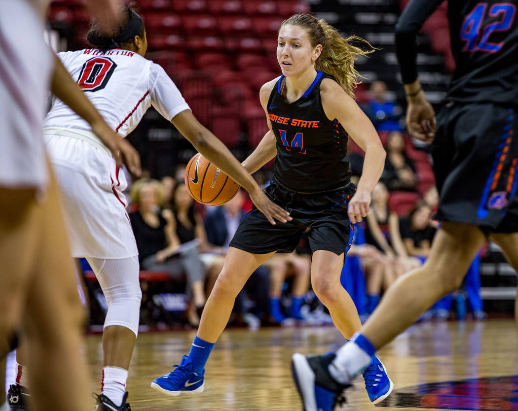 Boise State's Braydey Hodgins (14) tries to dribble around Kennedy Wharton (0) while Boise State's A'Shanti Coleman (42) runs past at the Thomas & Mack Center in Las Vegas on Saturday, Feb. 3, ...