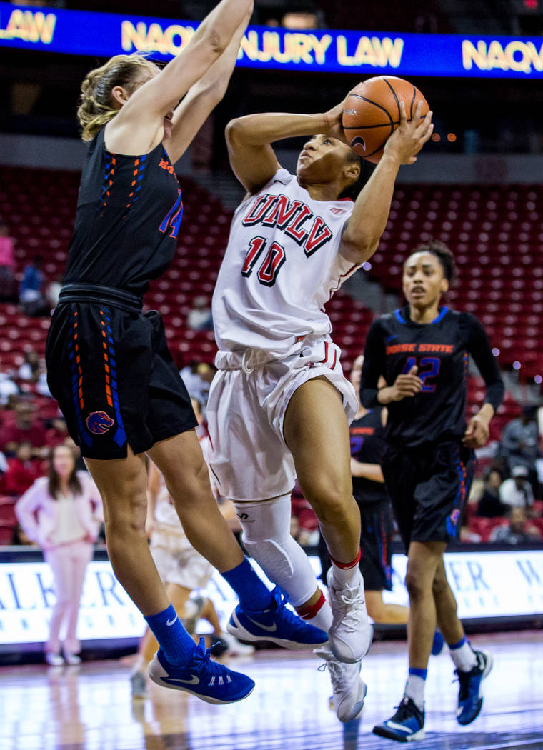 UNLV's Nikki Wheatley (10) tries to drive past Boise State's Braydey Hodgins (14) while A'Shanti Coleman (42) watches in the background at the Thomas & Mack Center in Las Vegas on Saturday, Fe ...