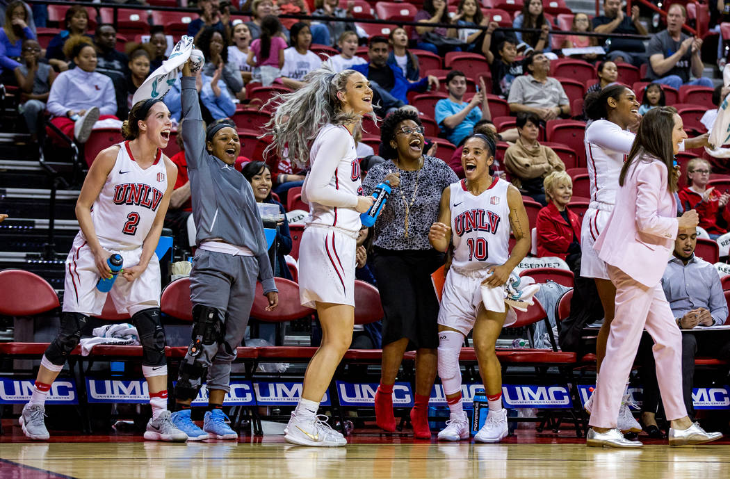 UNLV players and coaches celebrate after defeating Boise State 77-54 at the Thomas & Mack Center in Las Vegas on Saturday, Feb. 3, 2018.  Patrick Connolly Las Vegas Review-Journal @PConnPie
