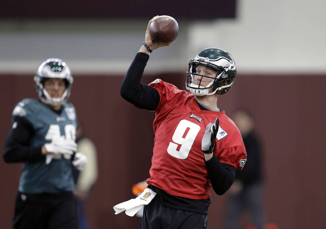 Philadelphia Eagles quarterback Nick Foles (9) throws during a practice for the NFL Super Bowl 52 football game Friday, Feb. 2, 2018, in Minneapolis. Philadelphia is scheduled to face the New Engl ...