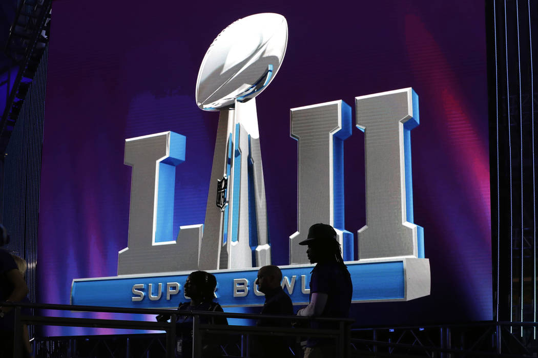 Fans wait in line to view the Lombardi trophy at the NFL Experience for the NFL Super Bowl 52 football game Tuesday, Jan. 30, 2018, in Minneapolis. The Philadelphia Eagles are scheduled to face th ...