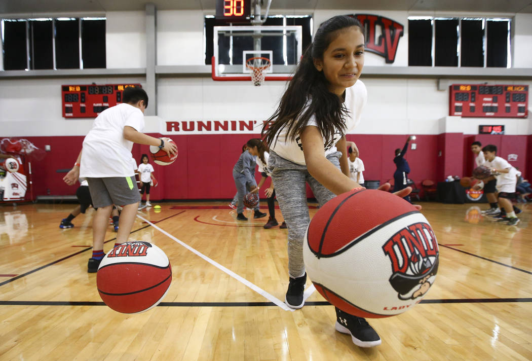 Jasmine De La Rosa, 12, participates in an activity as After-School All-Stars students from local middle schools participate in sports clinics led by UNLV student-athletes at Mendenhall Center at  ...