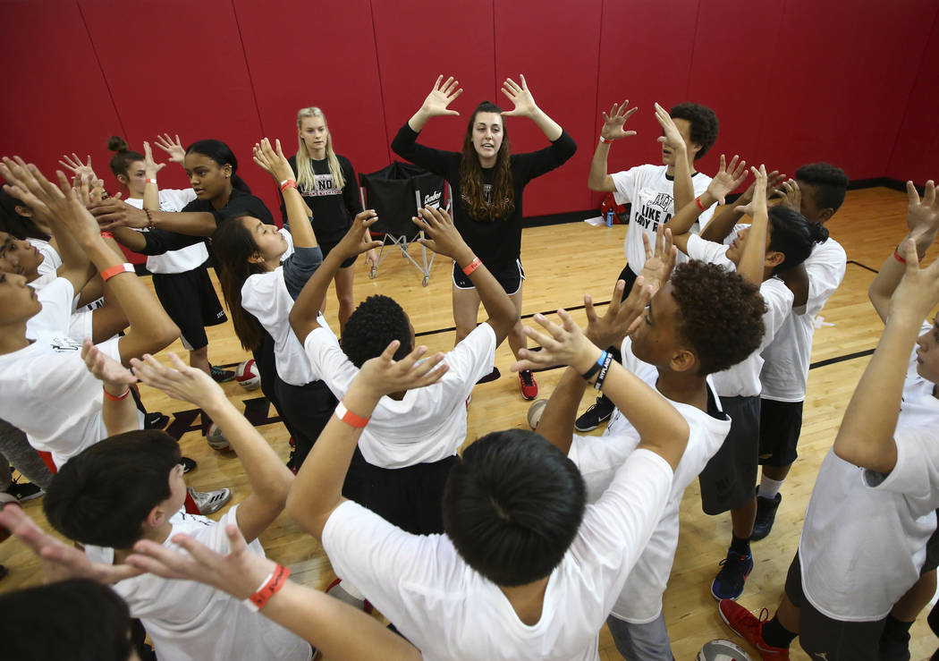 UNLV Volleyball player Riley Jacobs, center, leads After-School All-Stars students from local middle schools in an exercise at Mendenhall Center at UNLV in Las Vegas on Saturday, Feb. 3, 2018.  Ch ...