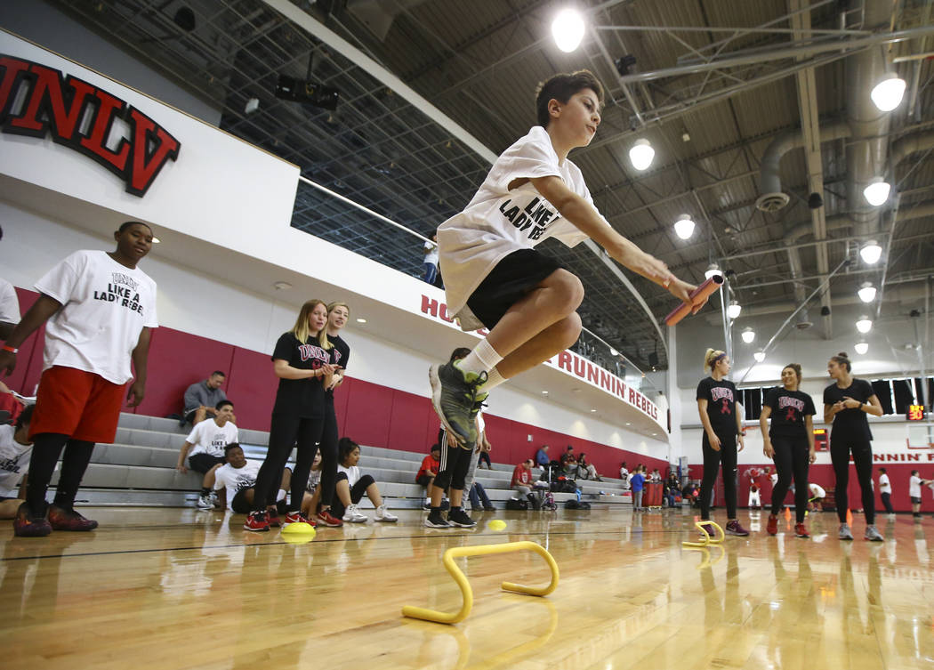 Clarke Holloway, 12, participates in an activity as After-School All-Stars students from local middle schools participate in sports clinics led by UNLV student-athletes at Mendenhall Center at UNL ...