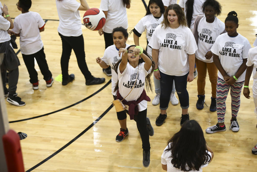 After-School All-Stars students from local middle schools take turns shooting a basketball while participating in sports clinics led by UNLV student-athletes at Mendenhall Center at UNLV in Las Ve ...