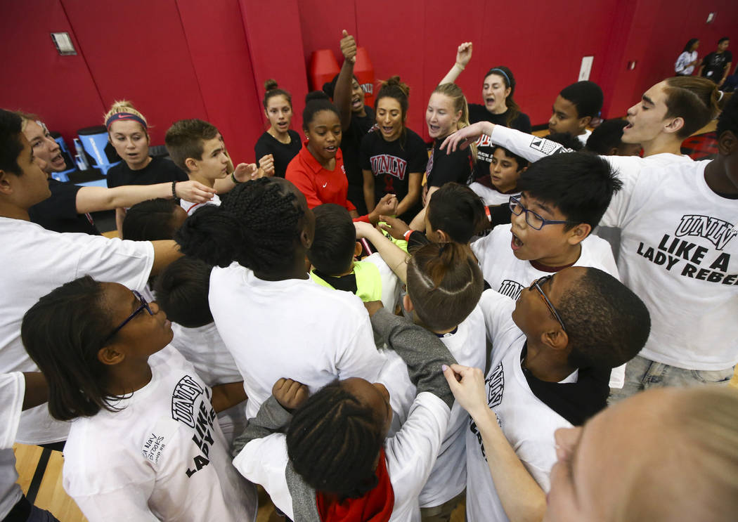 After-School All-Stars students from local middle schools huddle together while participating in sports clinics led by UNLV student-athletes at Mendenhall Center at UNLV in Las Vegas on Saturday,  ...