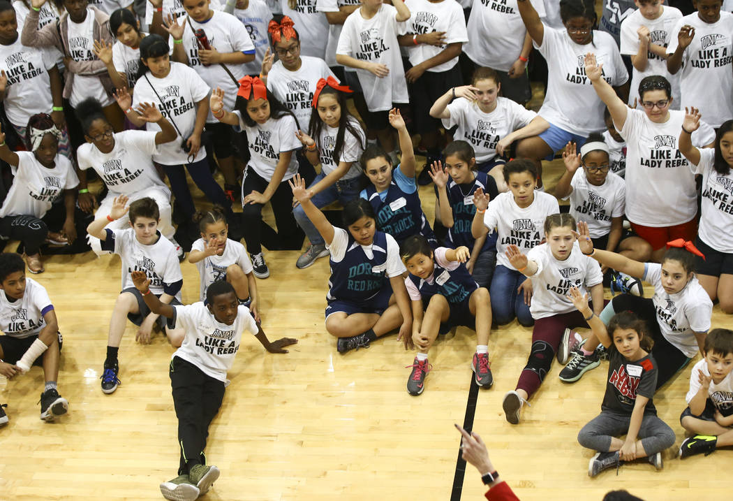 After-School All-Stars students from local middle schools pose for a photo after participating in sports clinics led by UNLV student-athletes at Mendenhall Center at UNLV in Las Vegas on Saturday, ...
