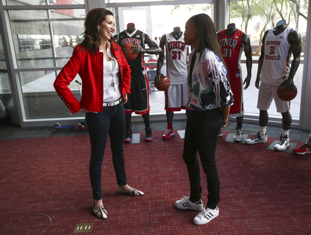 UNLV Athletic Director Desiree Reed-Francois, left, talks with Las Vegas Aces player Moriah Jefferson following an event with After-School All-Stars students from local middle schools participate  ...