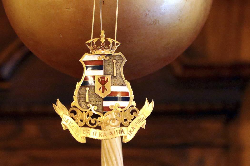 The Royal Hawaiian coat of arms hangs in the throne room at Iolani Palace in Honolulu. (AP Photo/Caleb Jones)