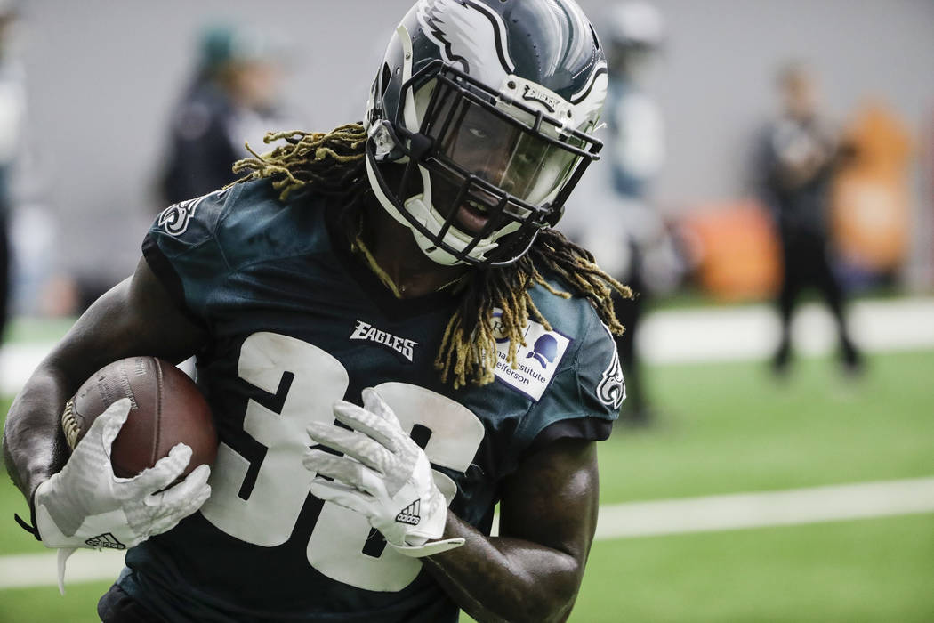 Philadelphia Eagles' Jay Ajayi runs the ball during practice at the team's NFL football training facility in Philadelphia, Friday, Jan. 26, 2018. The Eagles face the New England Patriots in Super  ...