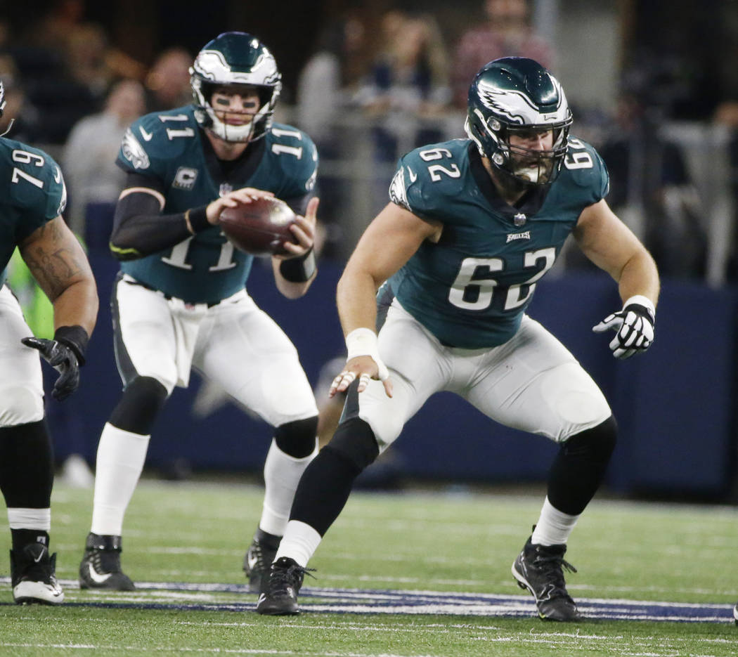 Philadelphia Eagles center Jason Kelce (62) prepares to block after snapping the ball to quarterback Carson Wentz (11) as they played against the Dallas Cowboys during an NFL football game, Sunday ...