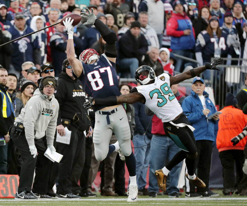 Jacksonville Jaguars safety Tashaun Gipson (39) breaks up a pass intended for New England Patriots tight end Rob Gronkowski (87) during the first half of the AFC championship NFL football game, Su ...