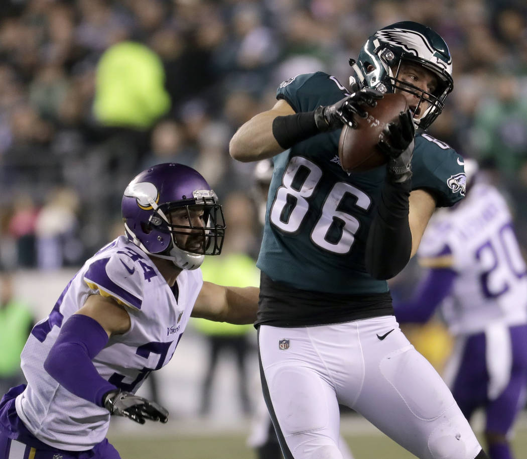 Philadelphia Eagles' Zach Ertz catches a pass in front of Minnesota Vikings' Andrew Sendejo during the first half of the NFL football NFC championship game Sunday, Jan. 21, 2018, in Philadelphia.  ...