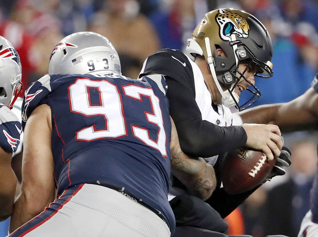 FILE - In this Jan. 21, 2018, file photo, Jacksonville Jaguars quarterback Blake Bortles (5) is sacked by New England Patriots defensive end Lawrence Guy (93) during the second half of the AFC cha ...