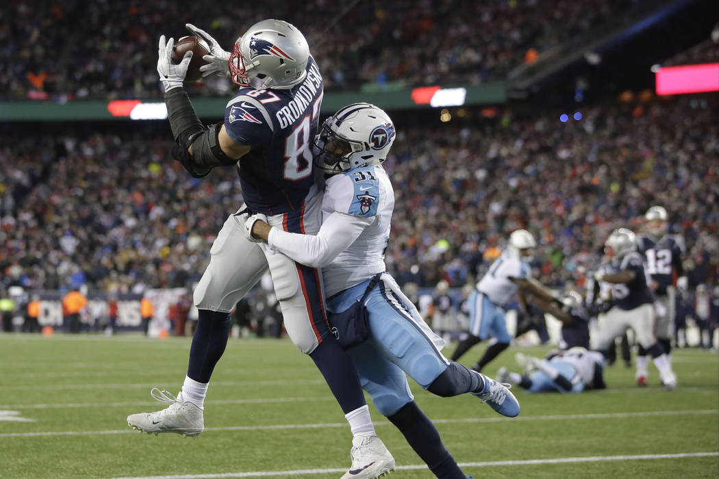 FILE - In this Saturday, Jan. 13, 2018, file photo, New England Patriots tight end Rob Gronkowski catches a touchdown pass with Tennessee Titans safety Kevin Byard (31) defending in the second hal ...