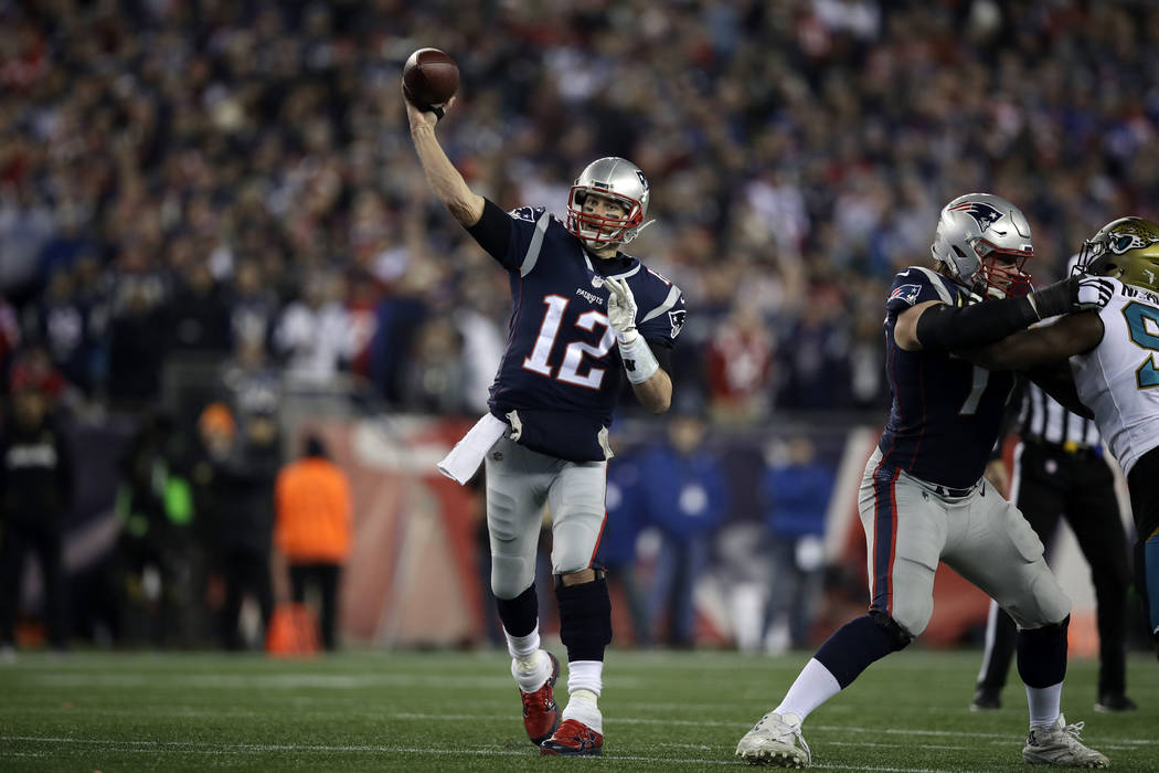 New England Patriots quarterback Tom Brady (12) throws against the Jacksonville Jaguars during the second half of the AFC championship NFL football game, Sunday, Jan. 21, 2018, in Foxborough, Mass ...
