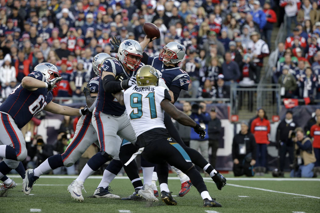 New England Patriots quarterback Tom Brady (12) throws against the Jacksonville Jaguars during the first half of the AFC championship NFL football game, Sunday, Jan. 21, 2018, in Foxborough, Mass. ...