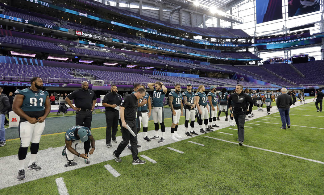 Philadelphia Eagles defensive tackle Fletcher Cox (91) and teammates prepare for a walk through for the NFL Super Bowl 52 football game at U.S. Bank Stadium, Saturday, Feb. 3, 2018, in Minneapolis ...