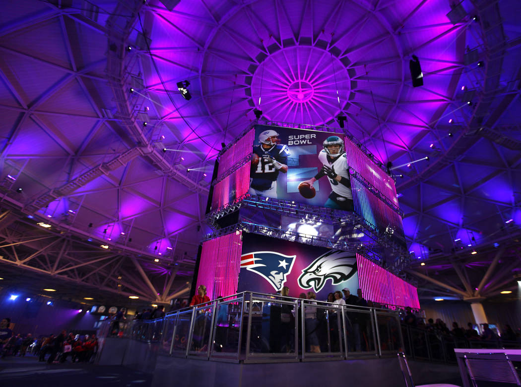 A banner featuring New England Patriots quarterback Tom Brady, left, and Philadelphia Eagles quarterbackNick Folesat the NFL Experience at the Minneapolis Convention Center in Minneapo ...