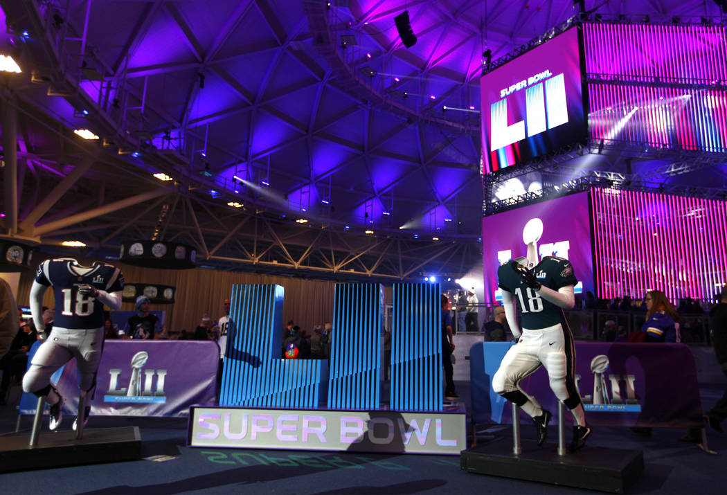 Jerseys of both Super Bowl teams, the New England Patriots, left, and the Philadelphia Eagles on display at the NFL Experience at the Minneapolis Convention Center in Minneapolis, Minn., Friday, F ...