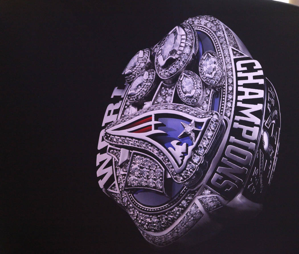 The New England Patriots fifth Super Bowl ring is displayed on a banner at the NFL Experience at the Minneapolis Convention Center in Minneapolis, Minn., Friday, Feb. 2, 2018. Heidi Fang Las Vegas ...