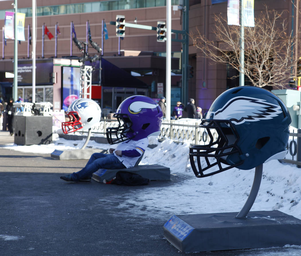A Minnesota Vikings fan sits inside the team's helmet on display at the NFL Experience at the Minneapolis Convention Center in Minneapolis, Minn., Friday, Feb. 2, 2018. Heidi Fang Las Vegas Review ...
